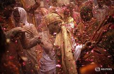 """""""Widows daubed in colours dance as they take part in the Holi celebrations organised by non-governmental organisation Sulabh International at a temple at…"""""""