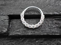 CZ diamond horizontal eternity hoop Daith earring / Cartilage / Septum ring / Nose ring Listing : single Material : Sterling silver 14 k gold plated Rose gold plated Stone : Clear cz round 2 mm Diameter : 9 mm Gauge : 16 gauge suitable for Daith piercing / Cartilage / Septum ring