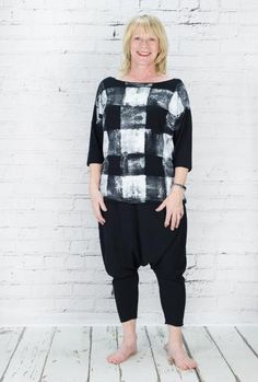 Latte printed check black and white top with 3/4 length sleeves. great with a pair of black harems or trousers.