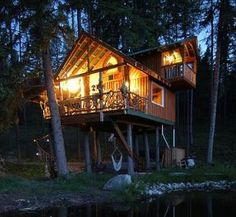 Spiral stairs, hammock, water, trees, indoor plumbing, lots of glass for lots of light...what more could you ask for? :)