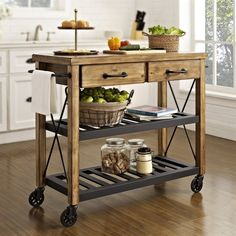 Roll out additional storage and prep surface with an industrial-style kitchen cart. Steel shelves are notched to secure wine bottles. Drawers and towel bars maximize culinary convenience.
