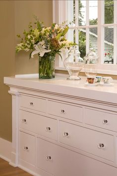 Gorgeous custom built-in dresser with glass knobs....<3<3<3