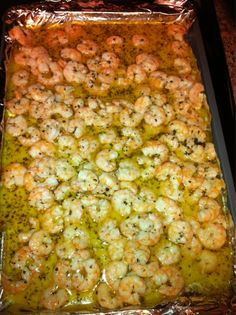 Garlic/Lemon/Butter/Shrimp  2 sticks of butter   1 extra large lemon juiced  6 cloves of garlic  2 tablespoons of basil  1 tablespoon of oregano   3.5 pounds of peeled shrimp    Melt butter. Add garlic, cook till tender. Add basil, oregano, and lemon. Simmer for 5 minutes. Pour over shrimp that should be lined on an oven pan with aluminum foil.    Bake at 400 for 12 minutes!