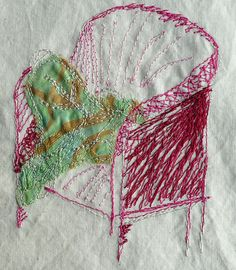 .embroidered chair with pillow