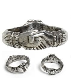 Fede Ring. 1400, Italy. Made from silver, two hands clasping a heart are engraved from the metal. This ring would have been a present to show a person's promise of everlasting love and fidelity