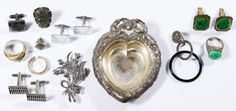"""Lot 278: 14k Gold and Sterling Silver Jewelry Assortment; Including a gold ring marked """"14k"""" inside band as well as marked """"sterling"""" items including (2) rings, (3) pairs of cuff links, (2) single cuff links, a pin adorned with marcasite, a tie tack, a single earring and a heart-shaped dresser tray"""