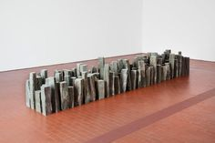 Richard Long - Long loves nature and occasionally expresses an appreciation for extremely old structures. It appears that this was intended to be a miniature homage to Stonehenge. Although instead using his other favourite shape (besides the circle). A line.
