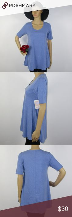 NWT Lularoe Perfect T Solid Light Blue Size XXS This cute top is new with tags! As always offers and bundles are welcome. Feel free to add one or more items to a bundle for a private discount offer!!!  Armpit to armpit is 16.5 inches across Waist is 17 inches across Length is 29 inches LuLaRoe Tops Tees - Short Sleeve