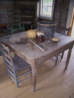 Primitive Table with Mismatched Chairs on Wide Plank Flooring Primitive Tables, Primitive Gatherings, Primitive Kitchen, Primitive Furniture, Primitive Antiques, Rustic Table, Country Primitive, Farmhouse Table, Primitive Decor