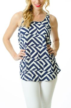 Our navy print top pairs perfectly with white pants or denim. #navyandwhite #navytop #printtop #geometricprint