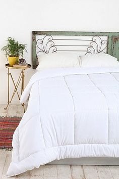 Terrace Door Headboard UO-Loving this headboard... thinking about making one out of two old storm windows!