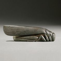 Babylonian Stone weight in the shape of a Grasshopper. Culture : Mesopotamian. Period : Babylonian, 18th-17th Century B.C. Material : Haematite.