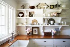 Kitchen inspiration: polished farmhouse.  Butcher block countertops, open shelving w/ accessible everyday dishes, farmhouse sink, fresh flowers.