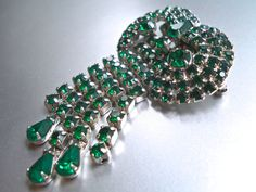 Offering an Art Deco green brooch by KRAMER of NEW YORK with fringe/dangle rhinestones and signed...vintage  This is a beautiful big brooch by KRAMER of NEW YORK, and hig... #fringe #dangle