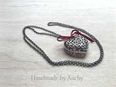 Silver colored heart pendant with silver by HandmadeByAnchy