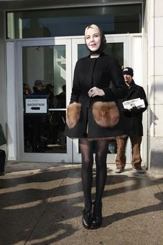 Ulyana in New York, wearing custom-made Ulyana Sergeenko Couture coat with sable fur pockets and underskirt