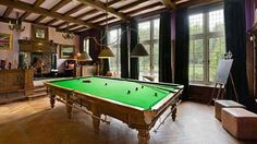Game on: The snooker room has a beamed ceiling, fireplace, and raised seating area. Snooker fan Ronnie was infamously a regular drinking par...