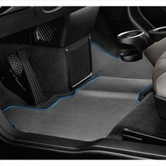 BMW i All Weather Floor Mats | The 3D-look all-weather floor mat fits perfectly with the innovative design of the continuous footwell and is also ideally matched to the overall BMW i interior. It is held securely by a BMW-approved restraining system and made from a newly developed, sustainable combination of plastic material that is dirt-resistant, waterproof and 100% recyclable. Waste created during production is also 100% recycled | $100