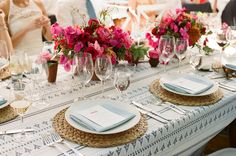 Moroccan inspired tablescape with blue and white patterned linen from La Tavola and bougainvellia floral centerpieces.