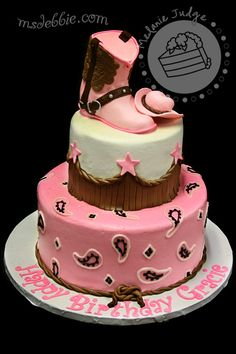 "Pink & Brown Cowgirl Cake - Cake was iced in buttercream and decorated with buttercream paisley pattern on the bottom tier and fondant ""leather"" strips on the top tier.  Cake was topped with hand-made gum paste cowgirl boot and hat."