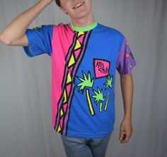 FEEEEEELIN IT! Check out this Funky NEON Vintage T-Shirt by Kozmik Designs NZ / XL / 100% Cotton / 1980's by TheHighwayThrifters on Etsy   #ootd #neon #1980s #ooak #fashion #trending #forsale #etsy #etsyshop #vintageclothing #vintagetshirt #vintageshirt #1980sfashion #thehighwaythrifters