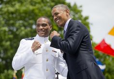 President Barack Obama and Ensign Taylor Teryle Tennyson strike a pose after he received his diploma and commission at the U.S. Coast Guard Academy graduation, Wednesday, May 20, 2015, in New London, Conn.