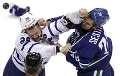 Coolest Sports Pix Of 2013 Week 44 - Vancouver Canucks Tom Sestito fights with Toronto Maple Leafs Colton Orr during the second period of their NHL hockey game in Vancouver.. BEN NELMS/REUTERS
