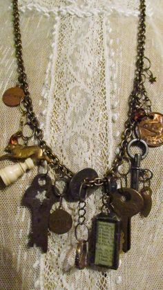 Necklace of Found Objects. Always Love these. I would have told you I have all kinds of tiny junk laying around. Until I saw these. Now I can't find nearly enough.