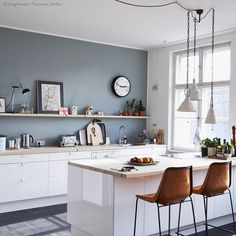 Delicieux Grey Wall With White Cabinets And Warm Brown Chairs. Crisp And Clean.  Kitchen With
