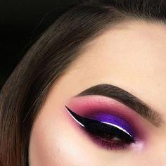 Magenta and purple smokey eye with metallic liner