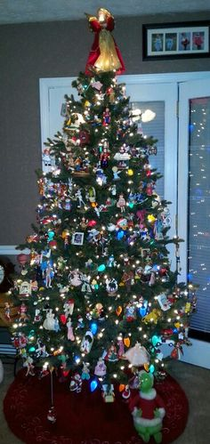 Tree full of hallmark ornaments. Looks just like my tree in the boys playroom in the basement!