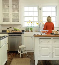 Warm wood floors, pretty white cabinets, all bathed in natural light from big windows!