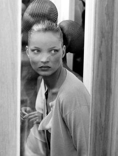 The preternaturally photogenic Kate Moss backstage at Matthew Williamson, 1997.