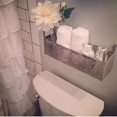 Extra storage with a shelf behind the toilet. Joanna Gaines, Instagram, HGTV, Magnolia homes. Organization ideas.