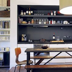 Like the black open shelves and arrangement of dishes, also the shelves on the far left, perfect for displaying cookbooks.
