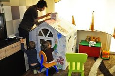 Playing with children with cardboard playhouse DIY creative