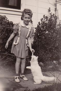 Crazy curls and a nonjudgmental cat. 1942.