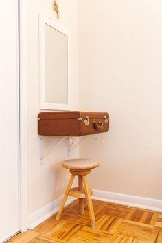 Love this suitcase shelf!