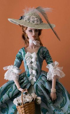A dress for fun. While I decide what I want to do I often make this Vogue dress. Silk with silk petticoat and ribbons. I made it to go with the hat really. IT doll Vanessa, my repaint.