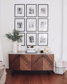 modern farmhouse foyer design with herringbone buffet with grid wall gallery wit. modern farmhouse foyer design with herringbone buffet with grid wall gallery with black and white photos, modern farmhou. Gallery Wall Frames, Frames On Wall, Modern Gallery Wall, Modern Farmhouse Gallery Wall, Modern Wall, Art Gallery, Living Room Cabinets, Living Room Bookshelves, Console Table Living Room