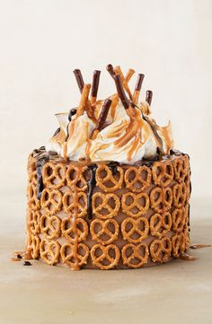 """""""Bring pretzels to your next party - cladding this choc-caramel cake like a biscuity armour. The pretzels cut through the sweet layers with a salty crunch and are softened by the silky meringue"""" - Michelle Southan. Sweet Recipes, Cake Recipes, Dessert Recipes, Cupcakes, Cupcake Cakes, Just Desserts, Delicious Desserts, Campfire Cake, Cupcake Decorating Tips"""