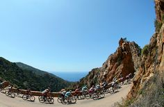 The peloton ride along the Corsican coast during stage three of the 2013 Tour de France, a 145.5KM road stage from Ajaccio to Calvi, on July 1, 2013 in Calvi, France.