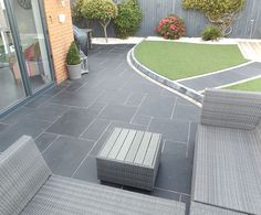 Garden patio ideas pictures carbon black limestone flagstones modern patio landscaping garden design seating construction ltd small patio garden design Back Garden Design, Backyard Garden Design, Patio Design, Backyard Patio, Backyard Landscaping, Modern Backyard, Patio Garden Ideas Uk, Terraced Patio Ideas, Stone Backyard