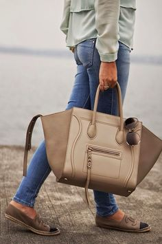 mint green blouse top + skinny jeans + cream tote purse