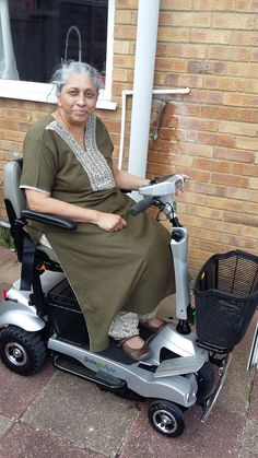 Mrs Malhotra on her Quingo Flyte mobility scooter