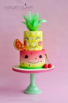 I loved making this cake inspired by the fruits of summer  and the ever trendy Japanese kawaii design. The bottom tier is a an ombré airbrush with black fondant pips to create the watermelon, and the pineapple is made from cut fondant...
