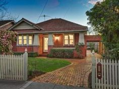 Brick californian bungalow house exterior with picket fence & hedging - House Facade photo 522833