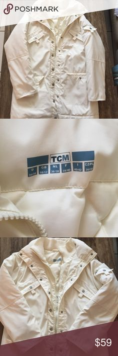 """TCM CREAM  DUCK DOWN JACKET 10/12 This is a very nice TCM JACKET IN A CREAM COLOR .  It is 100% polyester and duck down and duck feathers winter, ski and more Jacket in a size 36-38 or also a 10/12.  Has snap up and zip up front with multi pockets that snap.  Has a sweater like neck lining.  Super nice and warm JACKET/coat.  Flat under arm measures from side to side is 23"""", and 33 inches long.  Has 5 outside pockets and two inside pockets .  See photos for more condition details. TCM Jackets…"""
