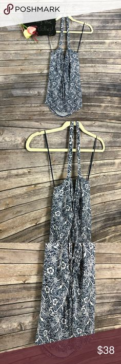 "Free People floral halter tie back sleeveless top Free People blue and white floral halter tie back sleeveless top. Really cute!! NWOT Size L.  15"" arm pit to arm pit.  28"" length.  9"" length of halter part of top. Free People Tops"