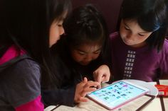 Kids playing with the Heckerty learning/reading app